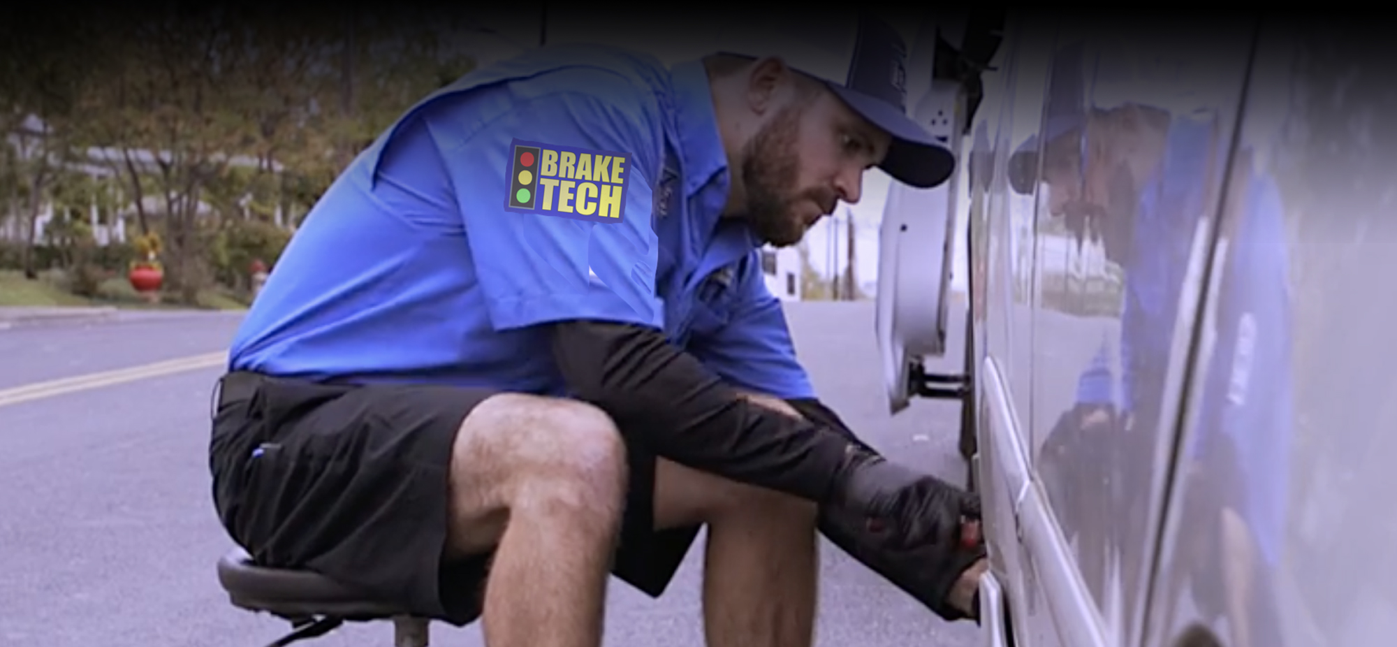 Brake Tech Mechanic working on a vehicle